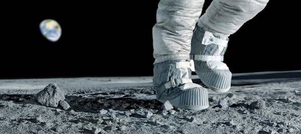 Photograph - Astronaut Walking On The Moon by Detlev Van Ravenswaay