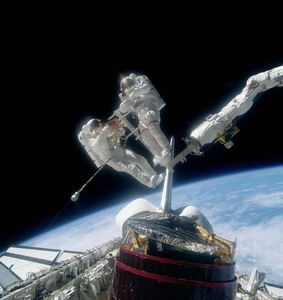 Iv Wall Art - Photograph - Astronauts Recovering Satellites by Nasa/science Photo Library