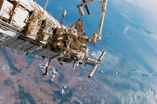 Iss Photograph - Astronauts Spacewalking Off The Iss by Nasa/science Photo Library