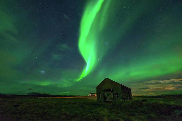 Reykjavik Photograph - Aurora Borealis Above Barn by Noppawat Tom Charoensinphon