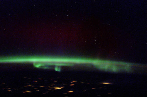 St. Petersburg Photograph - Aurora Borealis From Space by Nasa/science Photo Library