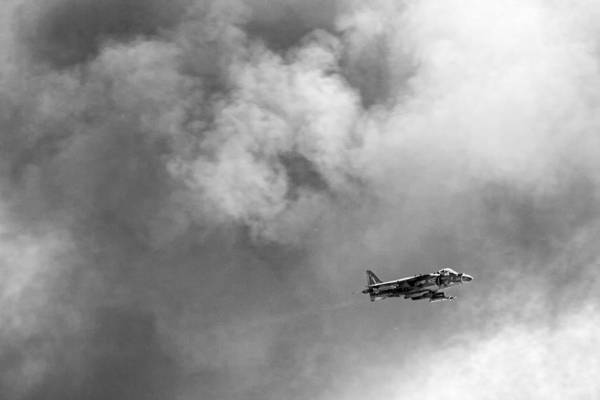 Air Show Photograph - Av-8b Harrier Flies Through The Smoke Of War by Peter Tellone