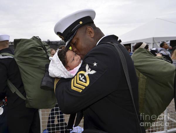 Norfolk Virginia Wall Art - Photograph - Aviation Ordnanceman Kisses His Newborn by Stocktrek Images