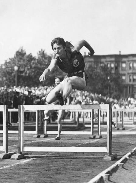 1931 Photograph - Babe Didrikson High Hurdles by Underwood Archives