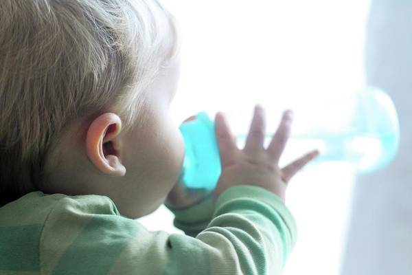 Wall Art - Photograph - Baby Boy Drinking From Bottle by Sigrid Gombert/science Photo Library