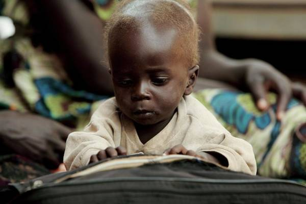 Uganda Wall Art - Photograph - Baby Playing With A Book by Mauro Fermariello/science Photo Library