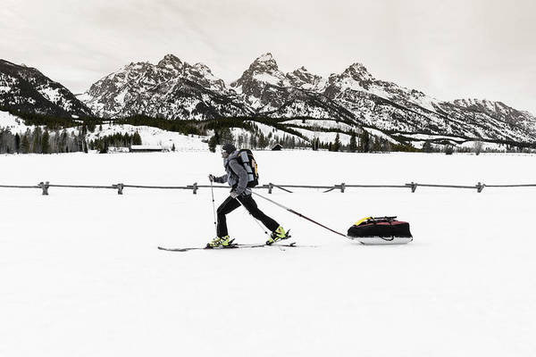 Wall Art - Photograph - Backcountry Skier Under The Tetons by Russ Bishop