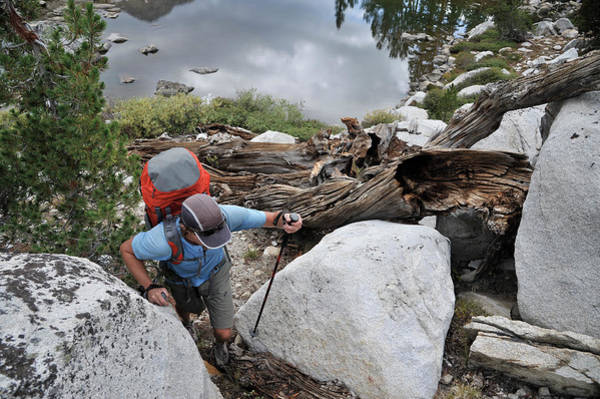 Wall Art - Photograph - Backpacker Hiking Across Lake Basin by HagePhoto