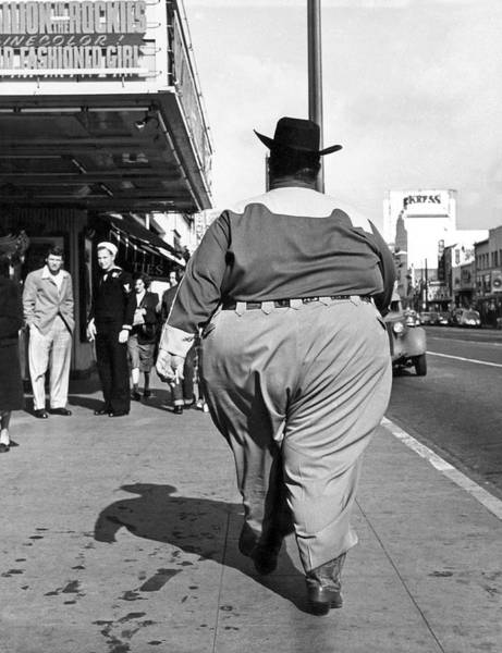 Forties Photograph - Backside Of Hefty Cowboy by -