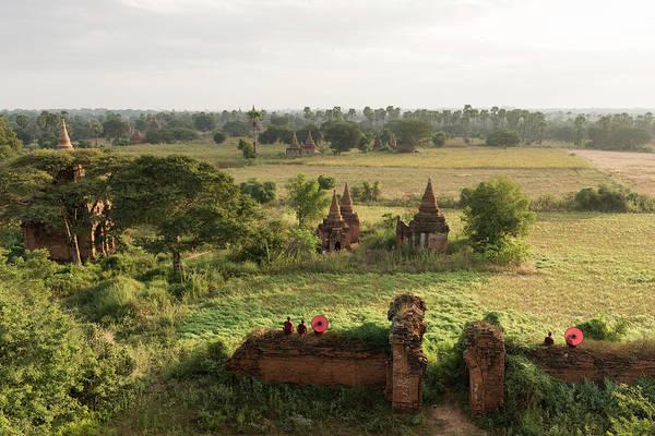 Buddhist Temple Wall Art - Photograph - Bagan, Buddhist Monks Sitting Amongst by Martin Puddy