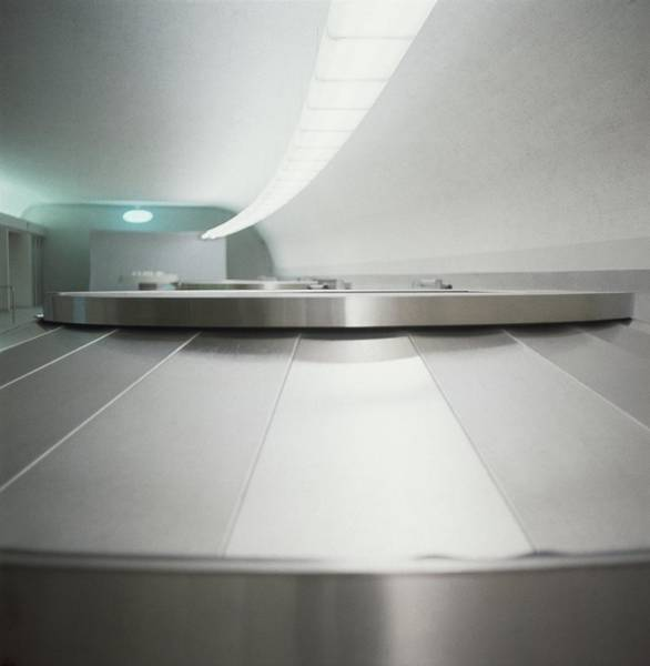 Luggage Photograph - Baggage Conveyor Belt by Horst P. Horst