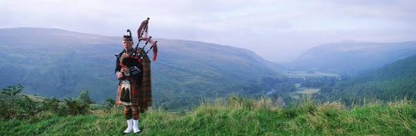 Bagpipe Wall Art - Photograph - Bagpiper At Loch Broom In Scottish by Panoramic Images