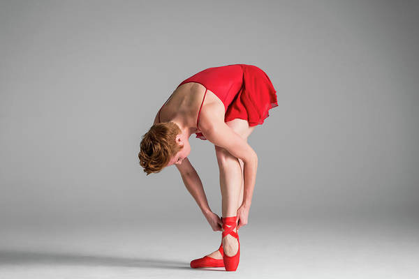 Red Dress Photograph - Ballerina In Red Adjusting Point Shoes by Nisian Hughes