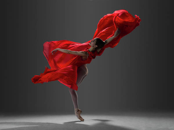 Red Dress Photograph - Ballerina Performing On Pointe In Red by Nisian Hughes