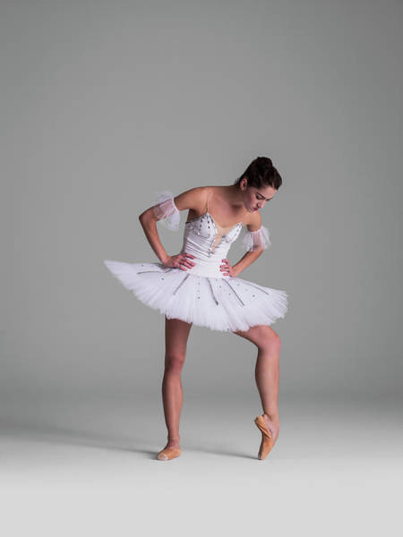 Hip Photograph - Ballerina Stretching Her Foot In Point by Nisian Hughes