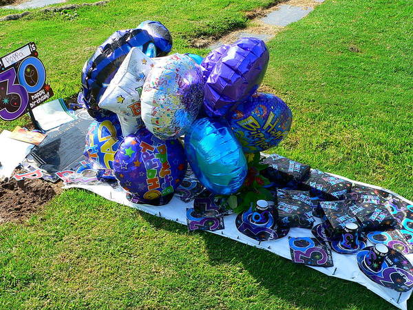 Photograph - Balloon Decorated Grave by Jeff Lowe