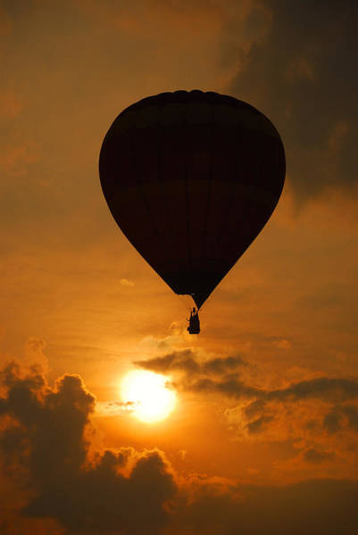 Photograph - Balloon Over Sunset by Songquan Deng