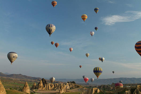 Cappadocia Photograph - Ballooning Over Cappadocia by Carol Polich Photo Workshops