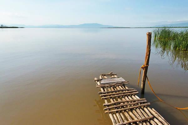 Lakes Region Photograph - Bamboo Raft On Lake Shalla by Keren Su