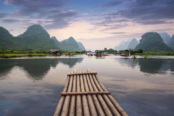 Raft Photograph - Bamboo Raft On Yulong River by Ray Wise