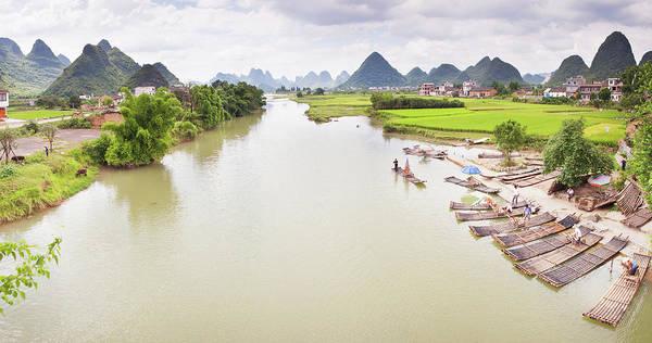 Raft Photograph - Bamboo Rafts On Banks Of Yulong River by Shayne Hill Xtreme Visuals