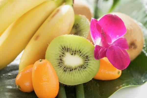 Kiwifruit Photograph - Bananas, Kiwi Fruit, Kumquats And Orchid by Foodcollection