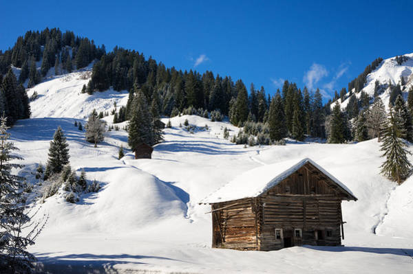 Photograph - Barn In Kleinwalsertal Austria Covered With Snow In Winter by Matthias Hauser