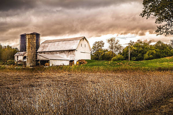 Photograph - Barn Silos Storm Clouds by Ron Pate