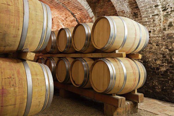 Brick Wall Photograph - Barrels In Wine Cellar by Stockwerk