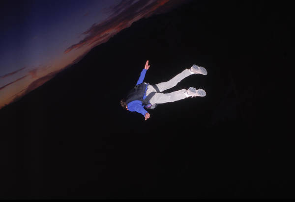 Base Jumping Photograph - Base Jumper Flies Toward Sunset by Jimmy Halliday