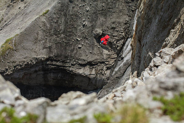 Base Jumping Photograph - Base Jumper Flying In Wingsuit In Swiss by Woods Wheatcroft