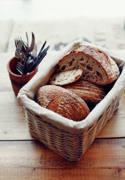 Mug Photograph - Basket Of Artisan Bread On Wooden Table by Jake Curtis
