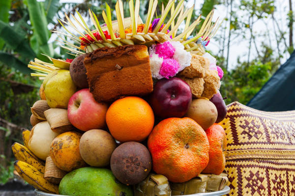 Indonesian Culture Photograph - Basket Of Fruits And Bakery Items by Panoramic Images