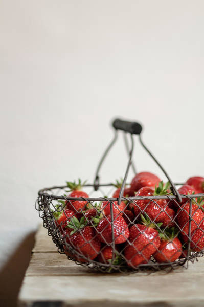 Handle Photograph - Basket Of Strawberries On Wooden Table by Westend61