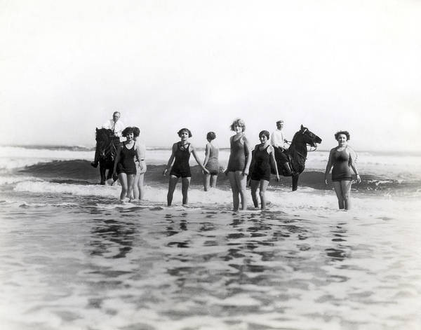 Wall Art - Photograph - Bathers And Horses In The Surf by Underwood & Underwood