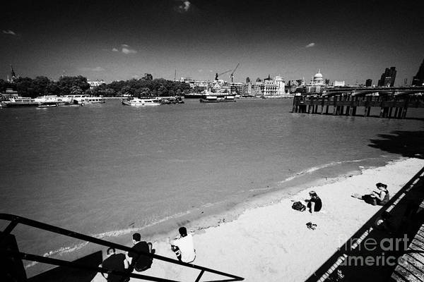Bankside Photograph - beach at gabriels wharf and view of north bank of the river thames London England UK by Joe Fox