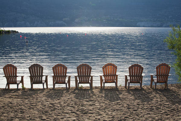 Deck Chair Photograph - Beach Chairs Lined Up On The Shoreline by Michael Interisano / Design Pics
