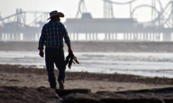 Texas Photograph - Beach Cowboy by John Collins
