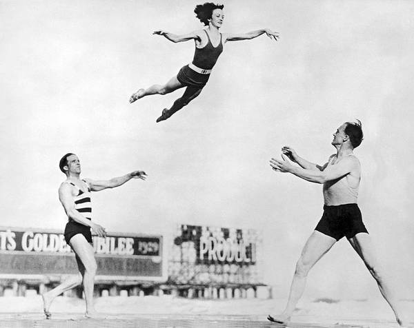 1929 Photograph - Beach Performers Toss Woman by Underwood Archives