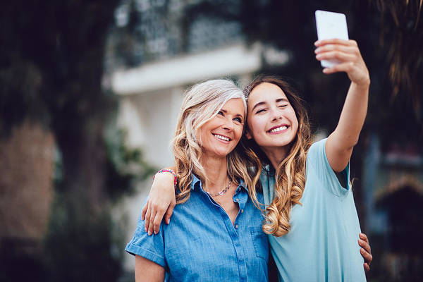 Beautiful Mature Mother And Adult Daughter Taking Selfies Together Art Print by Wundervisuals