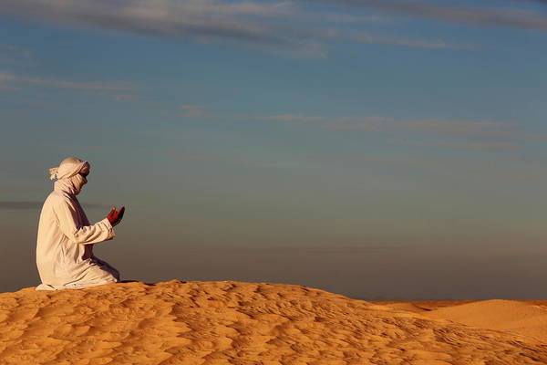 Tunisia Wall Art - Photograph - Bedouin Praying In The Sahara, Douz by Godong / Robertharding