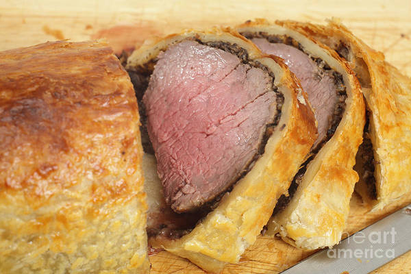 Photograph - Beef Wellington Slices On A Board by Paul Cowan