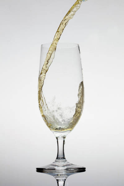 Alcohol Photograph - Beer Being Poured Into A Glass by Dual Dual