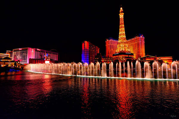 Photograph - Bellagio Fountain Show At Night by Greg Norrell