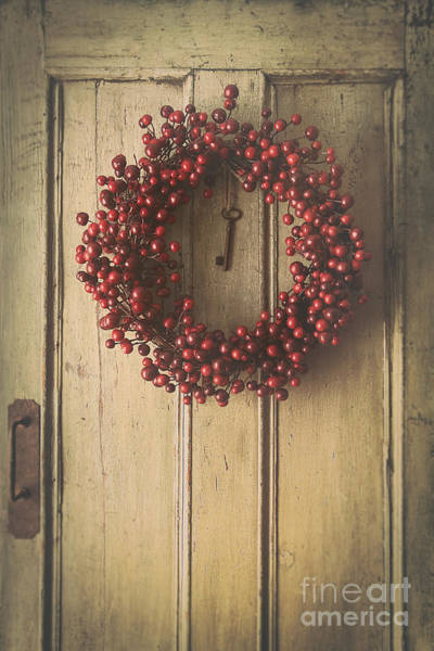 Photograph - Berry Wreath Hanging On Old Wood Door by Sandra Cunningham