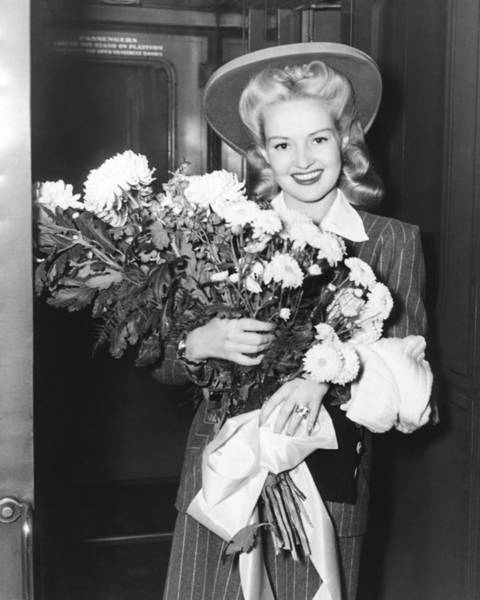 Grand Central Terminal Wall Art - Photograph - Betty Grable With Flowers by Underwood Archives