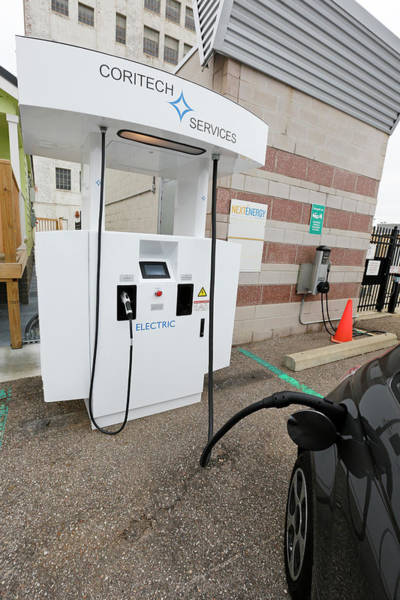 Plug-in Photograph - Bi-directional Electric Vehicle Charger by Jim West