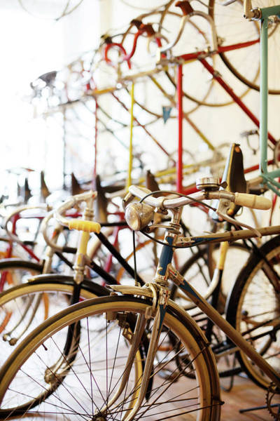 Workshop Photograph - Bicycles Parked In A Bike Shop by Alvarez