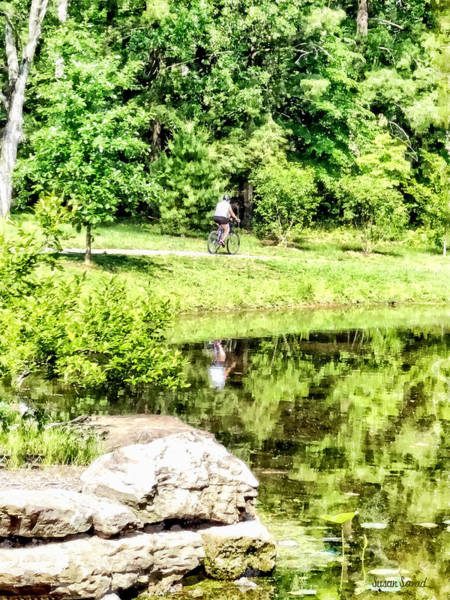 Photograph - Bicycling By The Lake by Susan Savad