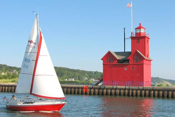 Holland Mi Wall Art - Photograph - Big Red And The Sailboat by Kathy Wesserling